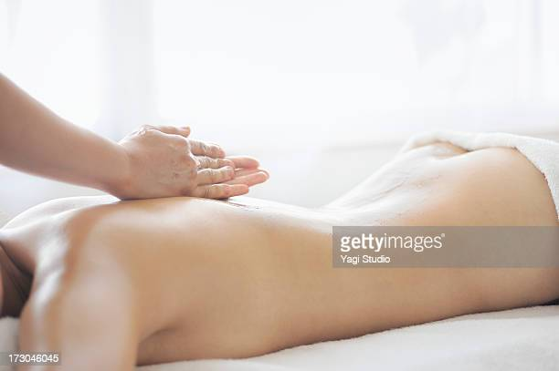 woman receiving oil massage and relaxing