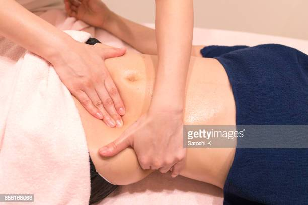 woman receiving oil massage