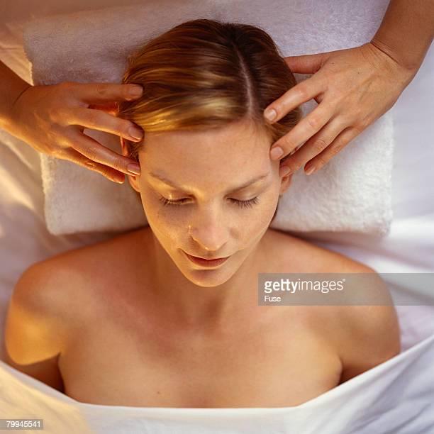 Woman Receiving Scalp Massage