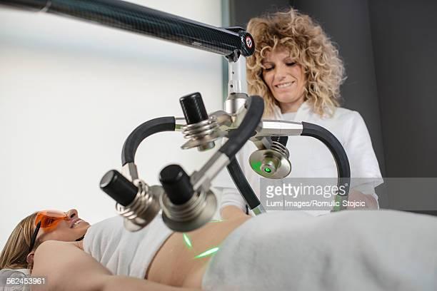 Woman receiving soft laser treatment