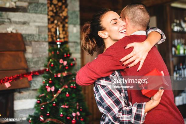 woman receiving gift from boyfriend at
