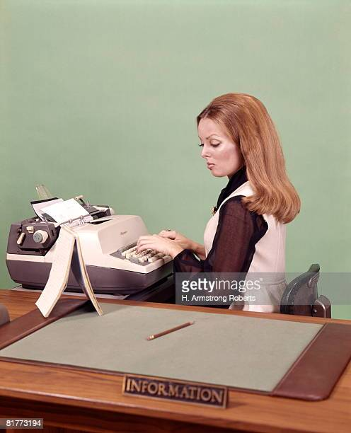 Woman Receptionist Secretary Sit At Information Desk Electric Typewriter Steno Pad Desk Blotter Typing.