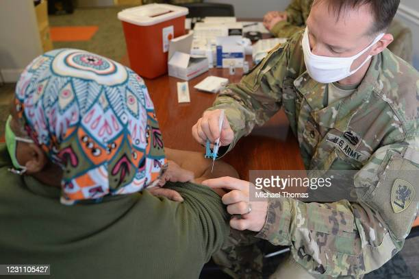 Woman recieves the Covid-19 vaccine during a vaccination event on February 11, 2021 at the Jeff Vander Lou Senior living facility in St Louis,...