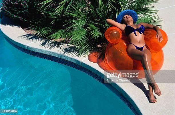 Woman Reclining by Swimming Pool
