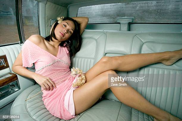 Woman Reclining in Back of Limo