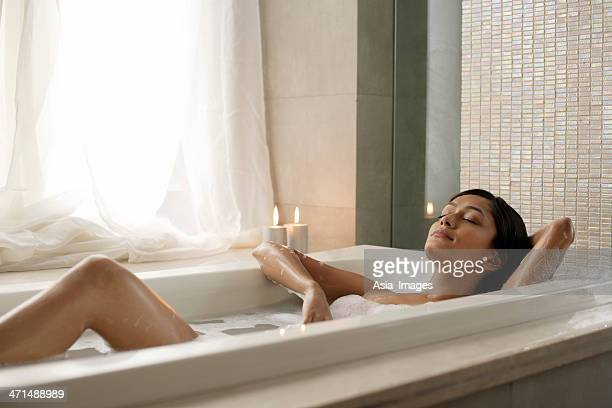 woman reclining in bathtub - taking a bath stock pictures, royalty-free photos & images