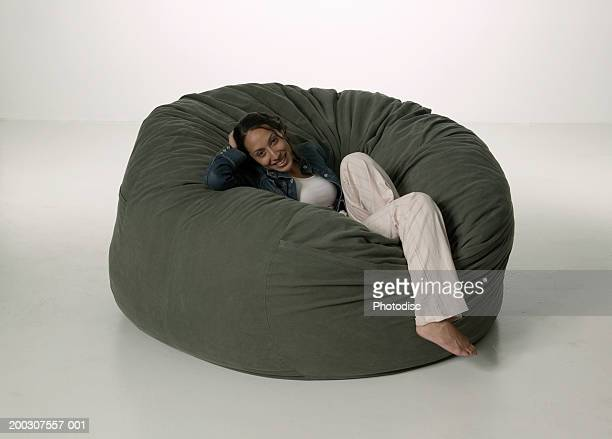Woman reclining on bean bag in studio