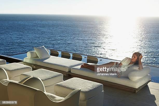 Woman reclining on sunlounger