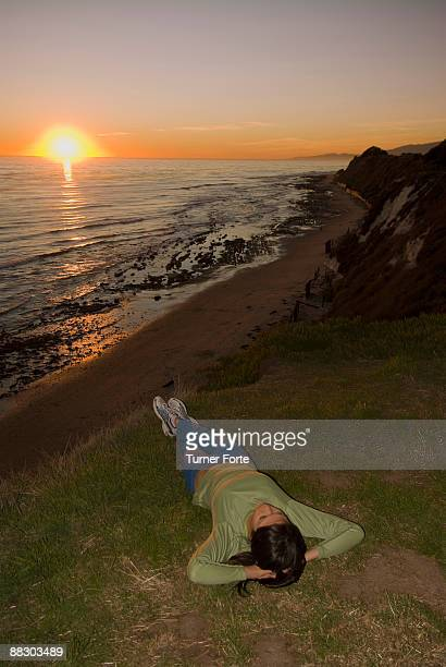Woman reclining on sunset beach