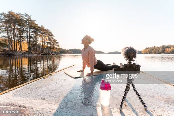 woman recording a vlog while exercising - influencer stock pictures, royalty-free photos & images