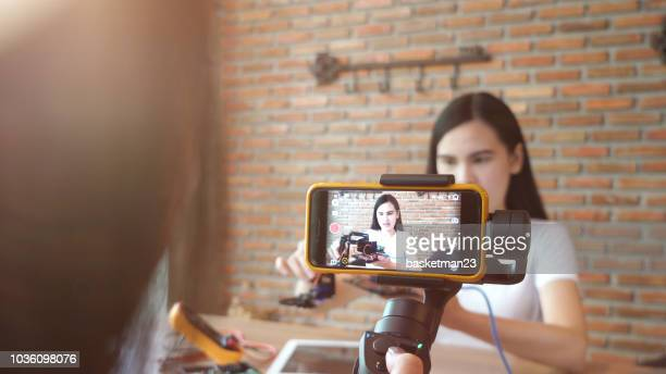 woman recording video for diy stuff preparation - sound recording equipment stock pictures, royalty-free photos & images