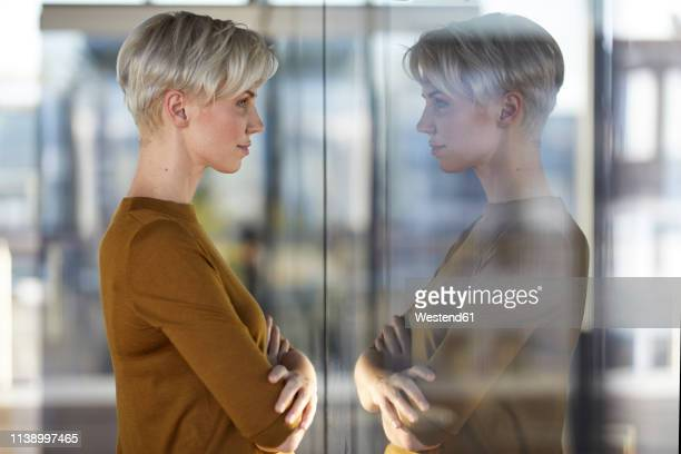 woman reflected in window - reflection stock pictures, royalty-free photos & images