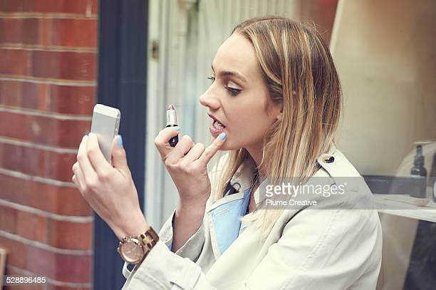 Woman refreshing make up