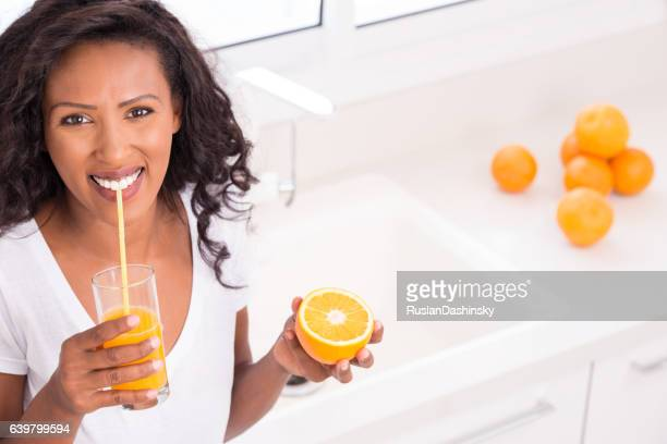 Woman refreshing with glass of juice.
