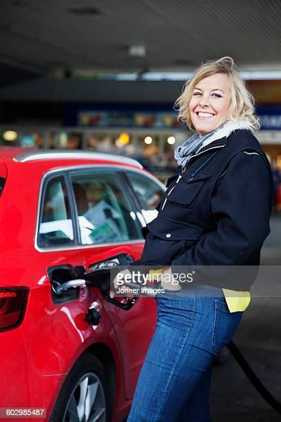 Woman refueling his car
