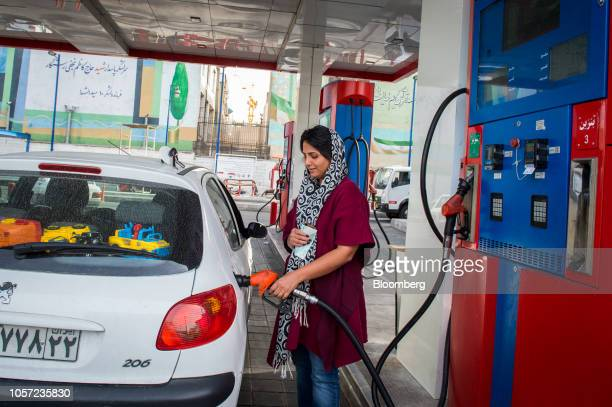 A woman refuels a vehicle at a Petroayric gas station in Tehran Iran on Saturday Nov 3 2018 Irans Supreme Leader Ayatollah Khamenei said US...