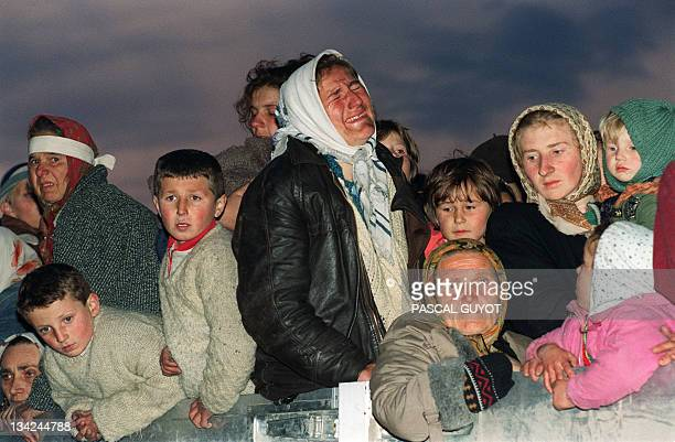 A woman refugee from the Serbbesieged Bosnian enclave of Srebrenica bursts into tears upon her arrival in Tuzla 29 March 1993 as part of some 2000...