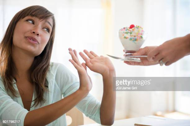 woman refusing unhealthy ice cream - unhealthy living stock pictures, royalty-free photos & images
