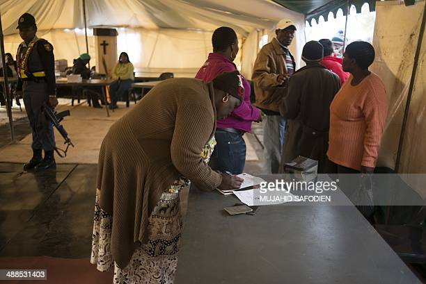 A woman registers to vote vote for the general elections on May 7 2014 at a polling station in Gugulethu South Africans vote in their fifth...