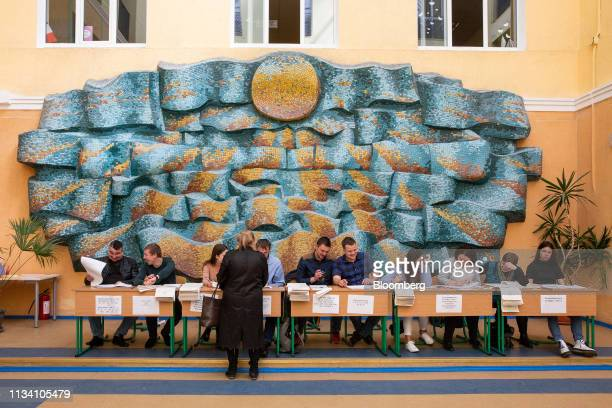 A woman registers with electoral staff at a polling station in Kiev Ukraine on Sunday March 31 2019 Ukrainians will choose between a field of almost...