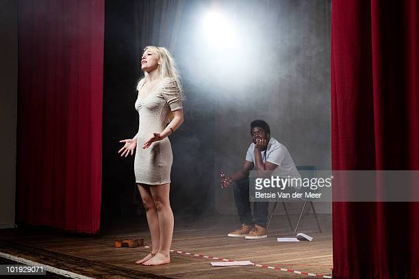 woman rehearsing on stage. - actor stock pictures, royalty-free photos & images