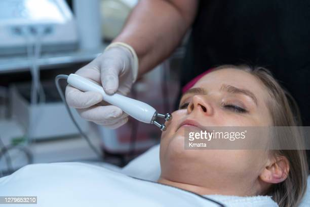 woman rejuvenating facial therapy treatment. - beauty treatment stock pictures, royalty-free photos & images