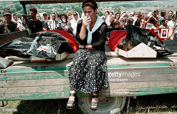 A Woman Relative Of An Ethnic Albanian Who Was Apparently Slaughtered By Serb Forces During The Nato Bombing Campaign Of Kosovo Sits Next To Bodies...