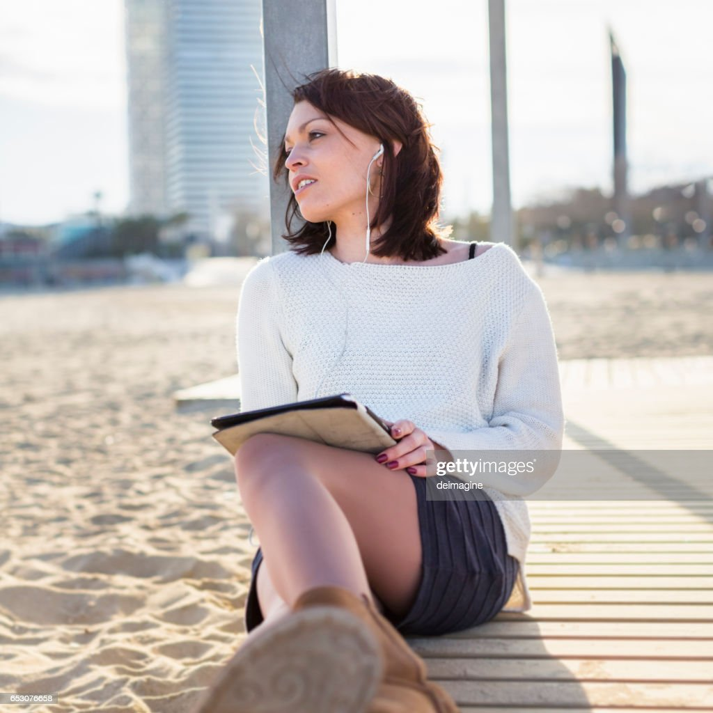 Woman Relax and Using a Tablet at the Beach : Stock Photo