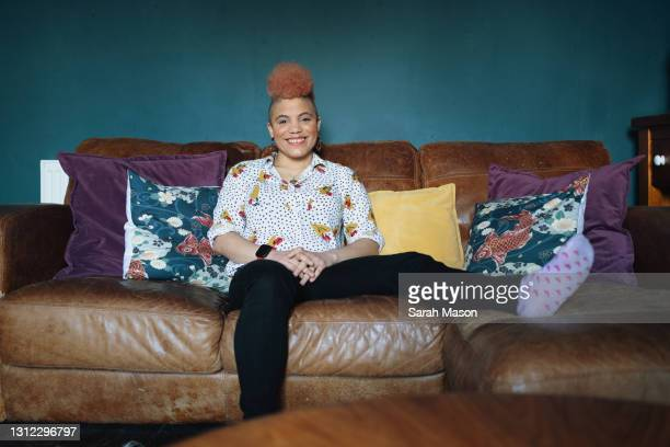 woman relaxed on sofa - one mid adult woman only stock pictures, royalty-free photos & images