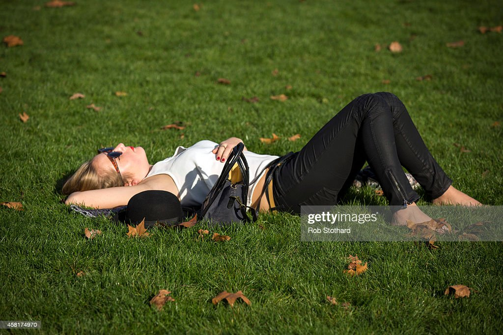 A woman relaxes in the sunshine in Green Park on October 31, 2014 in London, England. Temperatures in London are forecasted to exceed 20 degrees making today the hottest Halloween on record.