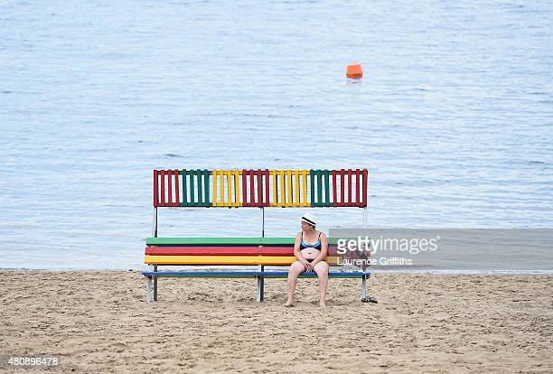 A woman relaxes on the beach at the edge of the Volga river in Samara during a media tour of Russia 2018 FIFA World Cup venues on on July 16 2015 in...