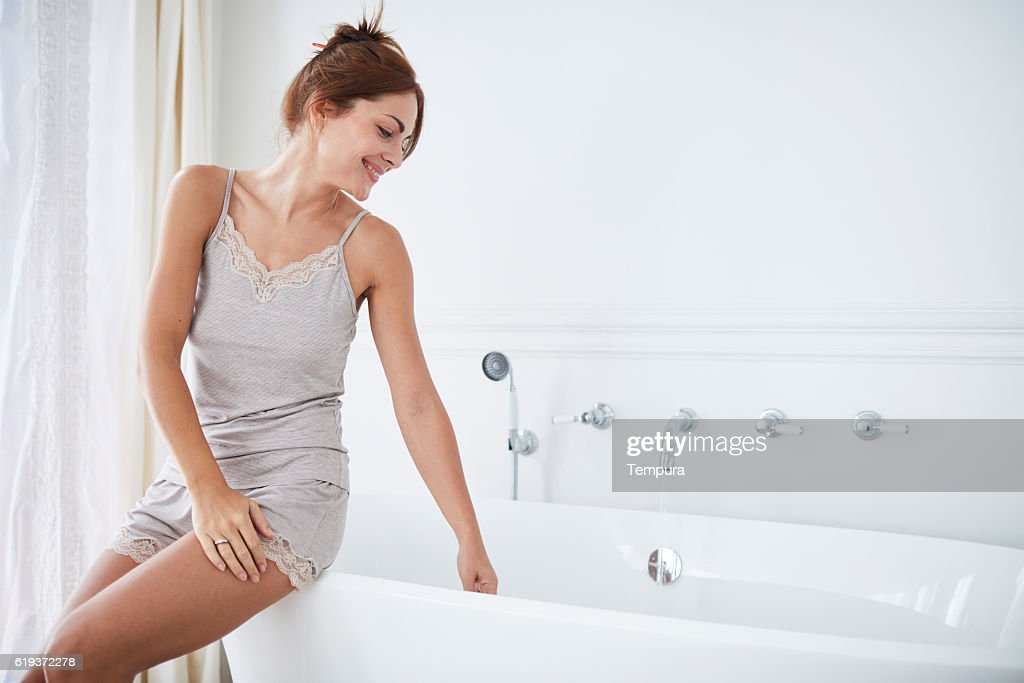 Woman relaxing a luxury bathroom. : Stock Photo