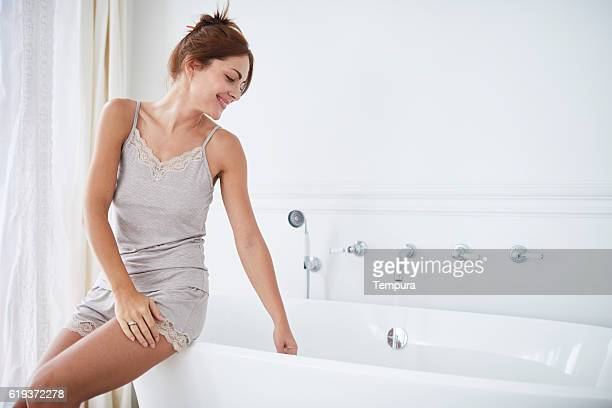 Woman relaxing a luxury bathroom.