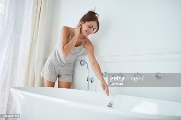 woman relaxing a luxury bathroom. - taking a bath stock pictures, royalty-free photos & images