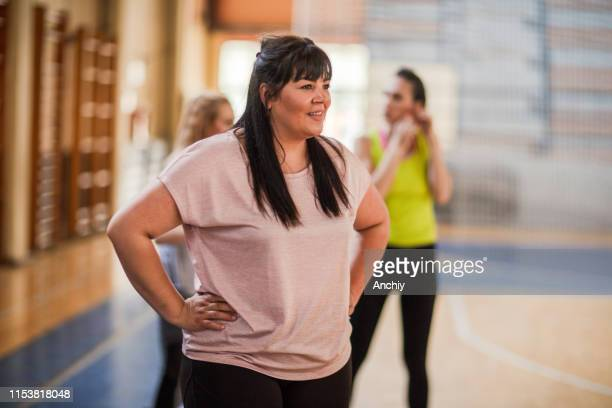 woman relaxing after dance class - practicing stock pictures, royalty-free photos & images