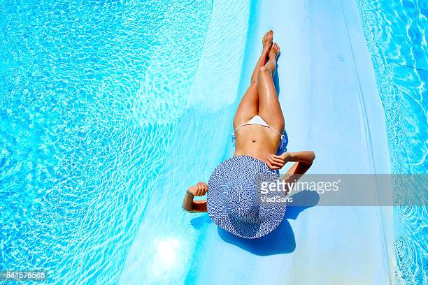 woman relaxing at a resort swimming pool - poolside stock pictures, royalty-free photos & images
