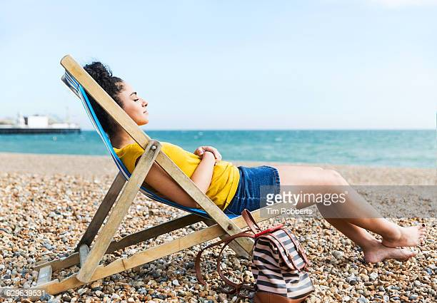 woman relaxing at beach. - tote bag stock pictures, royalty-free photos & images