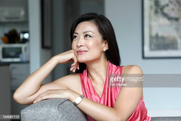 Woman relaxing at home, smiling