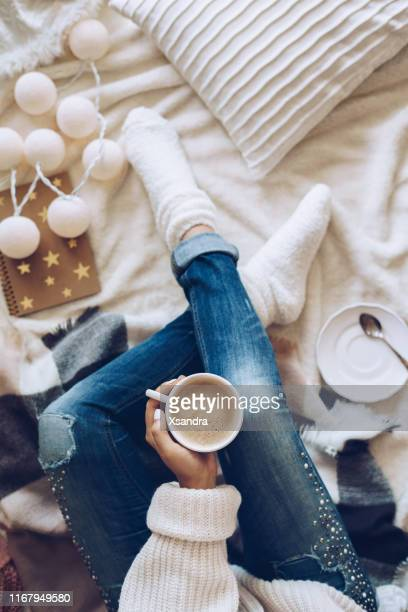 woman relaxing at home with a cup of coffee - cosy stock pictures, royalty-free photos & images