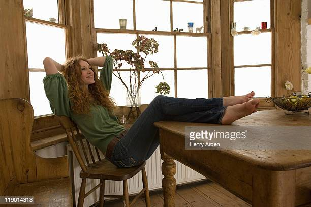 Woman relaxing at kitchen table