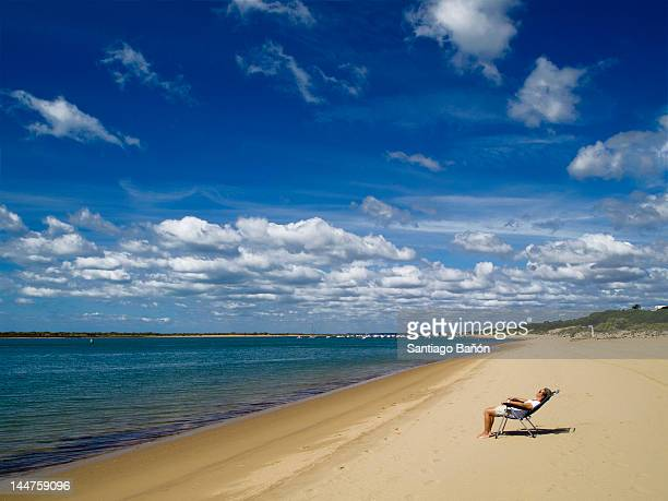 Woman relaxing at lonely beach