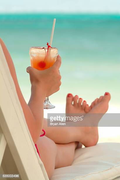 Woman Relaxing at the Beach with a Drink
