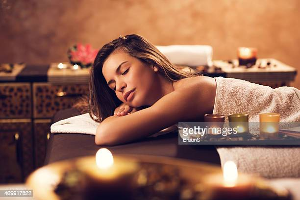 Woman relaxing at the spa with her eyes closed.