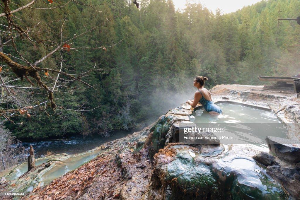 Woman relaxing at Umpqua Hot Springs, Douglas county, Oregon, United States. : Stock Photo
