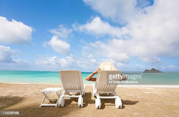 Woman relaxing beach chairs