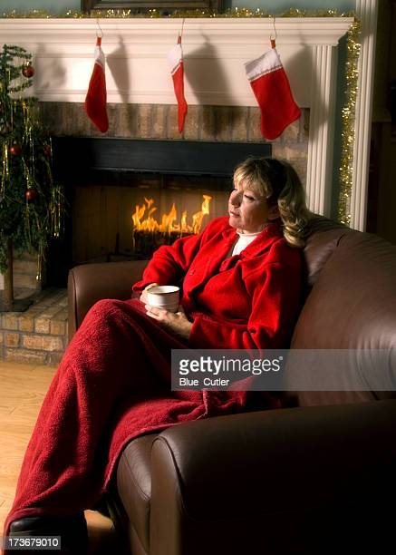 Woman relaxing by the Fireplace at Christmas