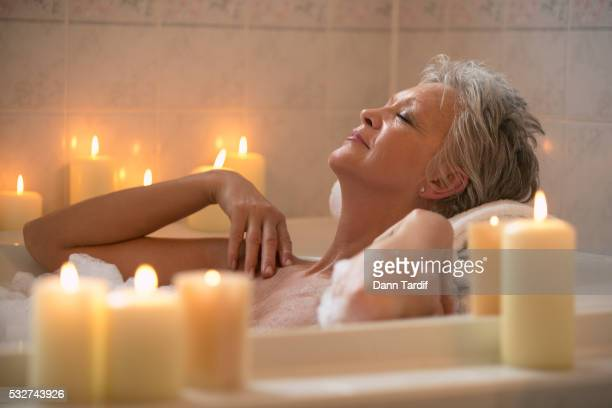 Woman Relaxing in a Bubble Bath