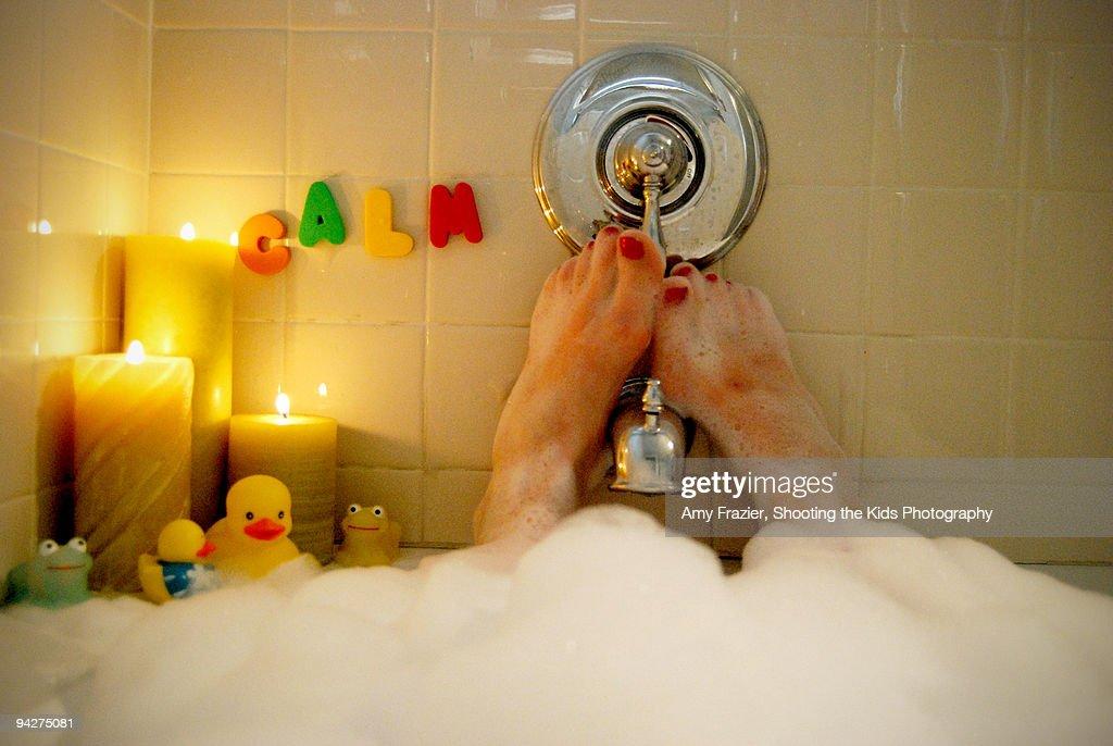 Woman relaxing in a bubble bath : Stock Photo