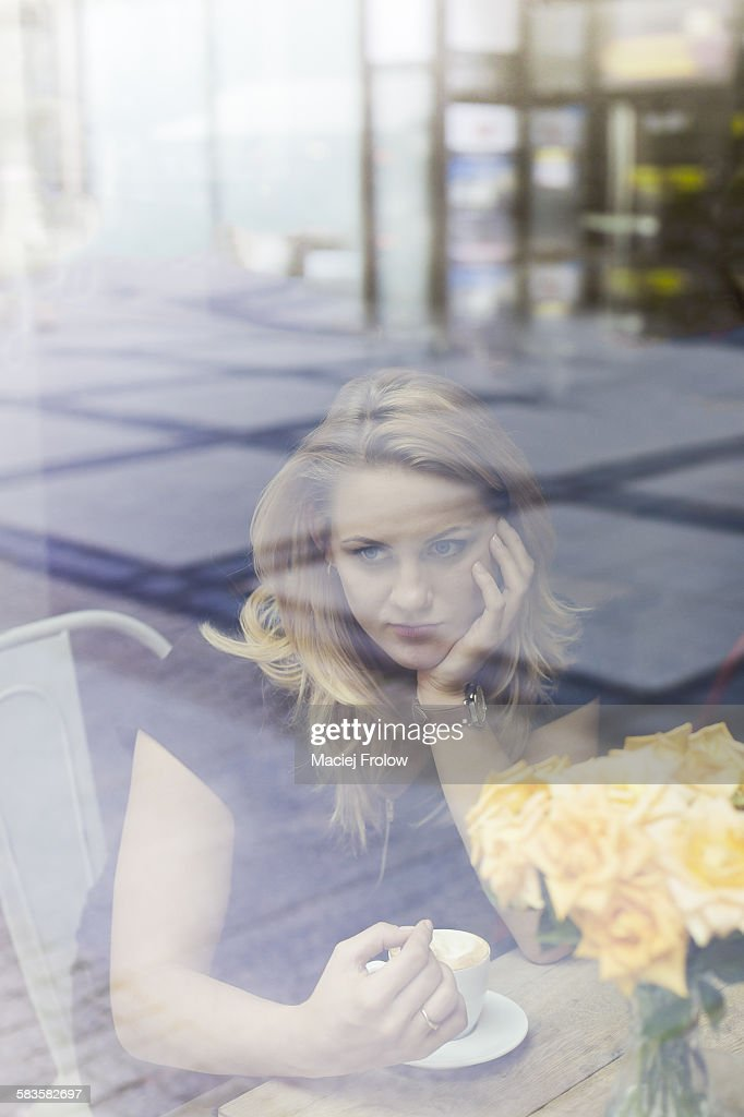 Woman relaxing in a cafe : Stock Photo