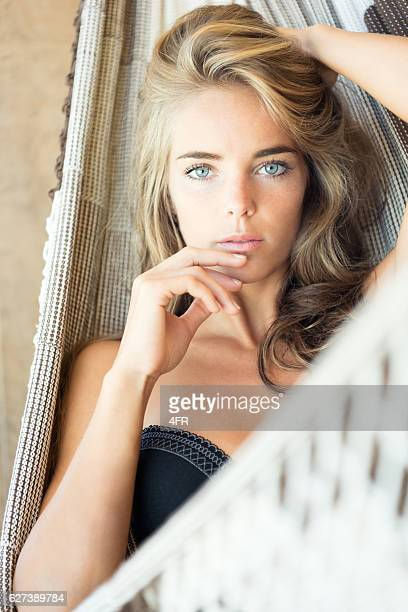 Woman relaxing in a Hammock on Vacation